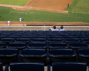 Two fans watch a Royals game