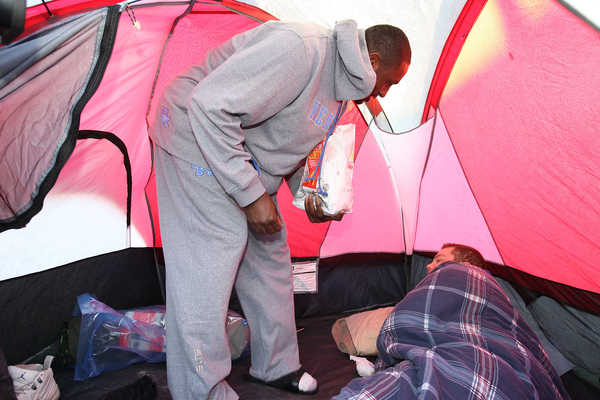 Patrick Patterson wakes a thankless tent hobo with a piping hot McMuffin.
